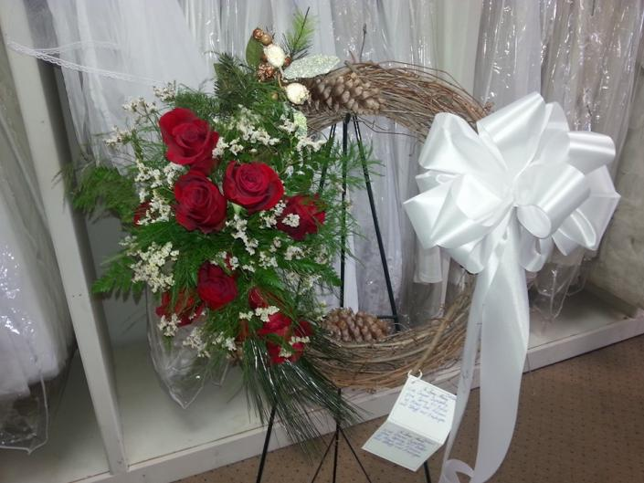 [Image: Honor a loved one with the help of Janet's Memories Bridal & Formal Wear. Order a fresh flower arrangement today.  ]