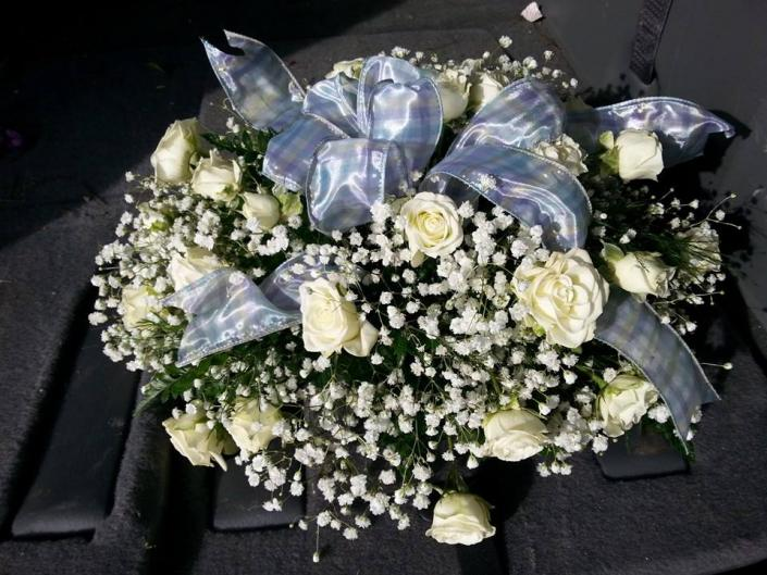 These bridal flowers are one our latest designs. White roses and baby breath with a hint of ribbon create a classic wedding bouquet style.